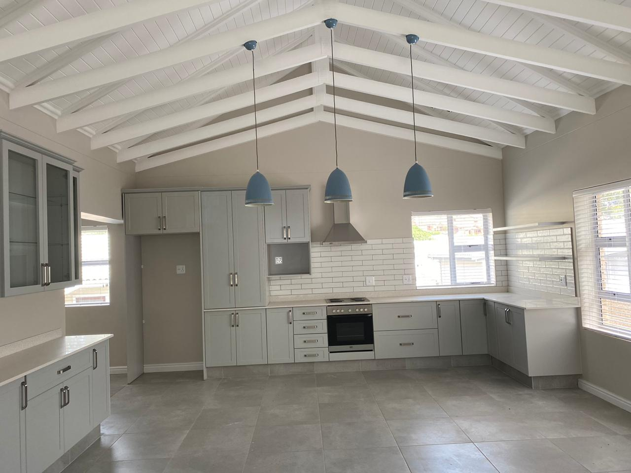 Kitchen with open beam roof - Newly built ranch-style house - Schoeman Trio Builders, Mossel Bay
