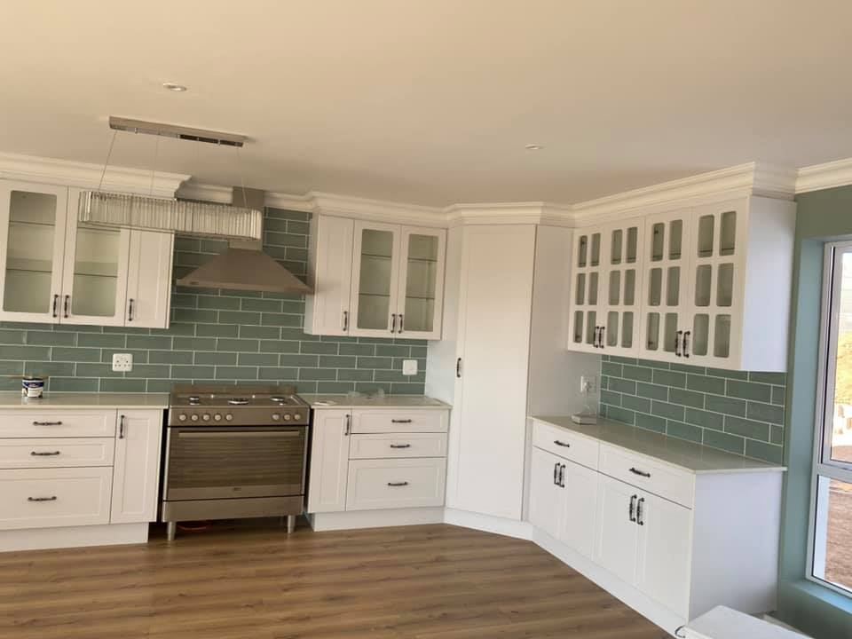 Kitchen - Newly built semi-neoclassical colonial house - Schoeman Trio Builders, Mossel Bay