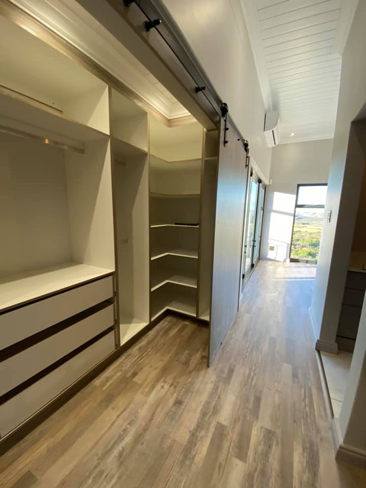 Cupboards - Stairway - New contemporary face brick construction in the Mossel Bay area by Schoeman Trio Builders